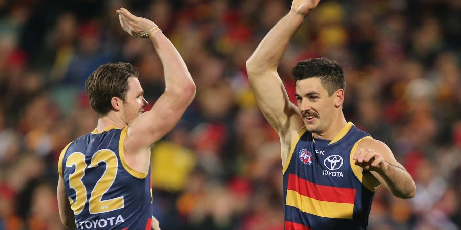 Walker stars as Crows thrash Lions