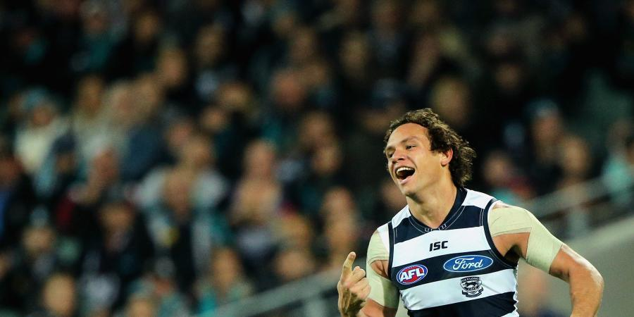 Enright, Motlop to play on for Cats