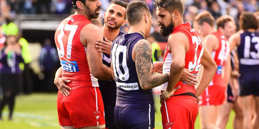 Dockers hold off valiant Swans in AFL