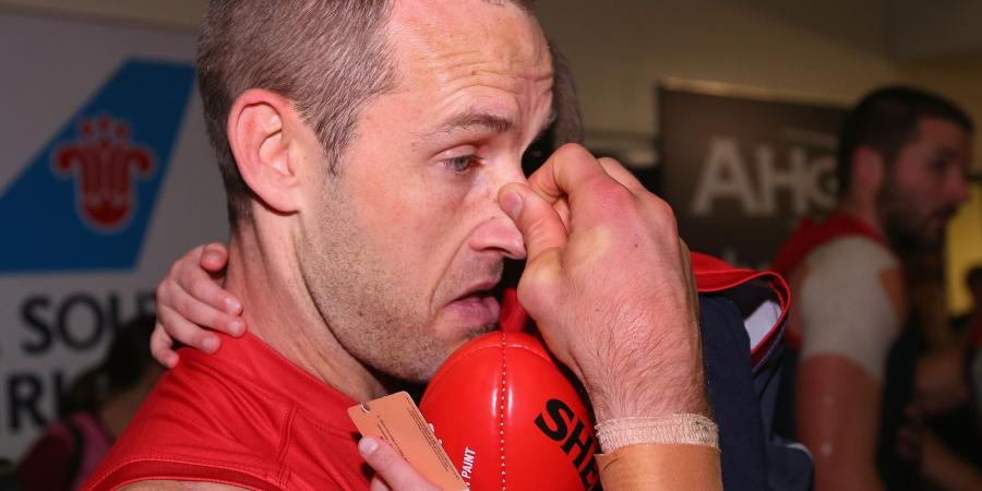 Demons cut four players from AFL list