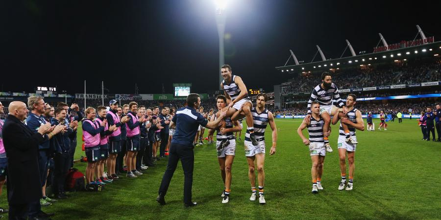 Cats celebrate with tough win over Dogs