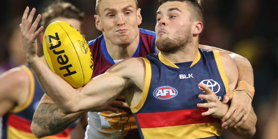 Crows young star re-signs