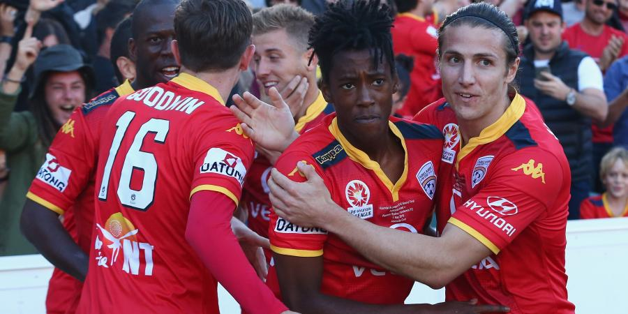 Djite applauds Kamau and Reds philosophy