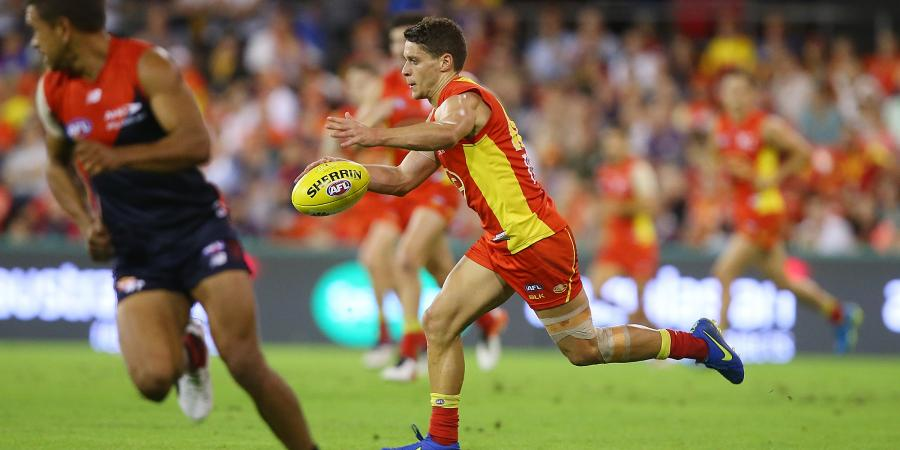 Suns star midfielder chased by three Victorian clubs, defender reportedly wants out