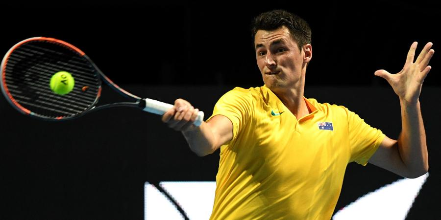 Trimmed down Tomic back in business